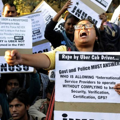 NEW DELHI, INDIA - DECEMBER 7: Jawaharlal Nehru University Students' Union (JNUSU) shout slogan against Delhi Police, hold protest against the shocking rape by UBER Cab Driver at PHQ ITO, on December 7, 2014 in New Delhi, India. A 27-year-old woman was allegedly raped by the driver of the cab she had hired through Uber to return home from a dinner party in Gurgaon on Friday night. The incident took place at around 9:30 pm when the woman, who works for a finance company in Gurgaon, was headed back to her home in north Delhi's Inderlok area. A rape case has been registered against the accused Shiv Kumar Yadav, 32 at Sarai Rohilla police station under Sections 376 (rape), 323 (voluntarily causing hurt) and 506 (criminal intimidation) of IPC. (Photo by Sonu Mehta/Hindustan Times via Getty Images)